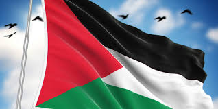 Young Palestinian woman flag - Red, black, white and green flag of Palestine waving in the wind with birds above it