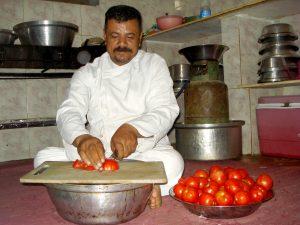 Ali Khosary making koshary in Dahab, Egypt