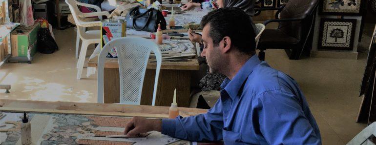 Fouad, a man from Idlib, Syria, working on a mosaic at a workshop in Jordan