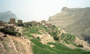 Brown mountains with scattered green - a village in Yemen