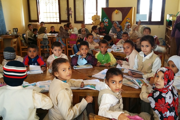 Small Egyptian children sit in a school room - working children in Egypt