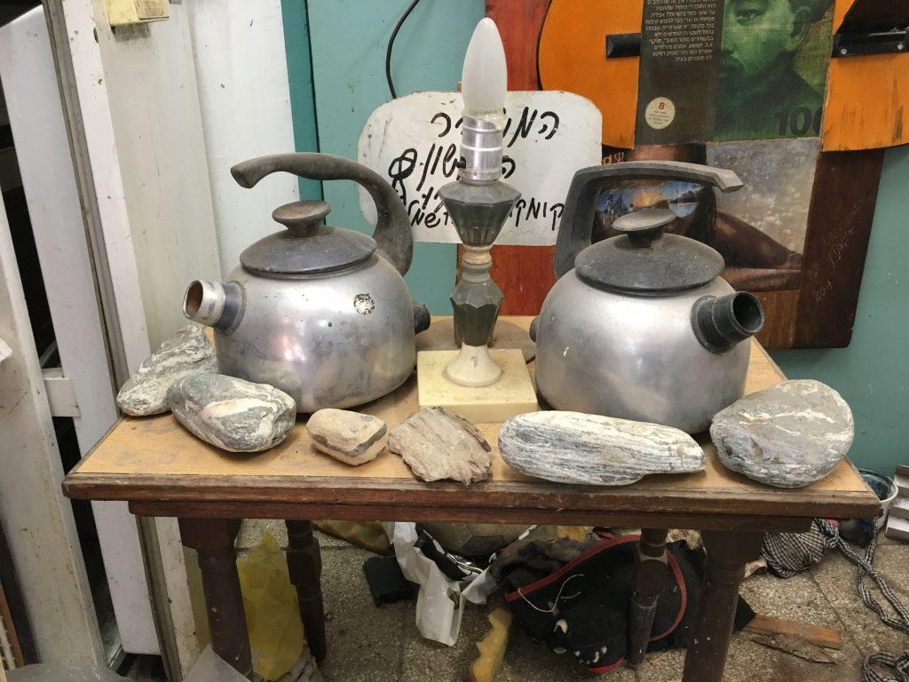 Two kettles, one lamp and several rocks from the beginning years of Kibbutz Beit Zera
