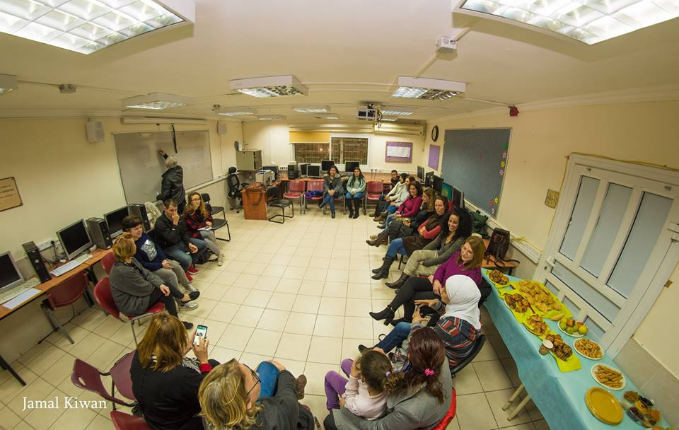 Kibbutz Beit Zera - Arabs and Jews sitting in a circle in a room in peace group L'Adeem Yahad