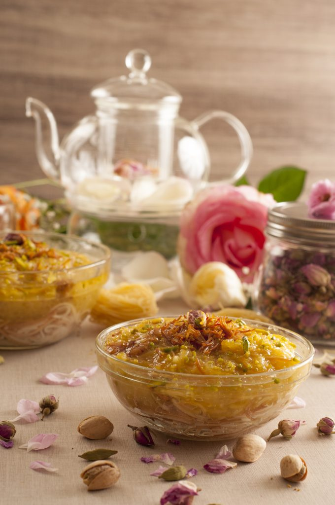 Small beautiful dishes surrounded by potpourri and flowers
